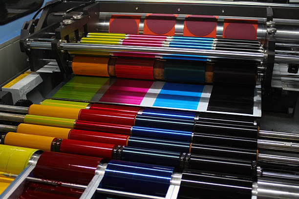 CMYK Ink rollers on an offset printing press